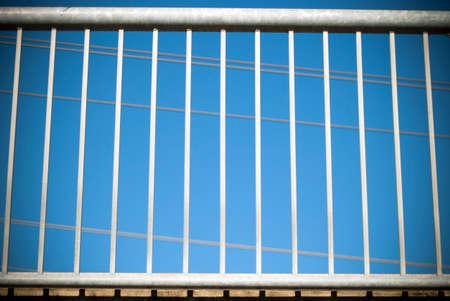 hand rail: Metal hand rail on overpass bridge