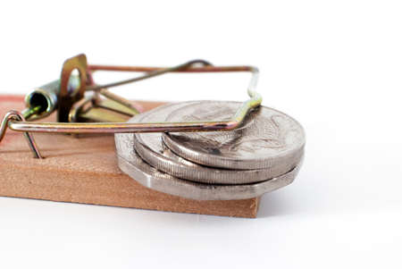 mousetrap: money trap, loaded mousetrap with coins on white background