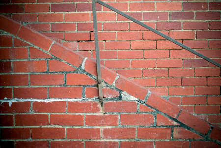 metal handrail: red brick wall background with metal handrail