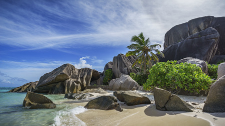Granite rocks and palm trees in the white sand at anse source dargent on la digue on the seychelles. Simply paradise...