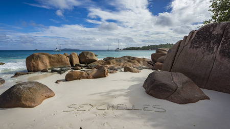 Catamarans at anse lazio on the seychelles. Turquoise water, granite rocks in the white sand on paradise beach