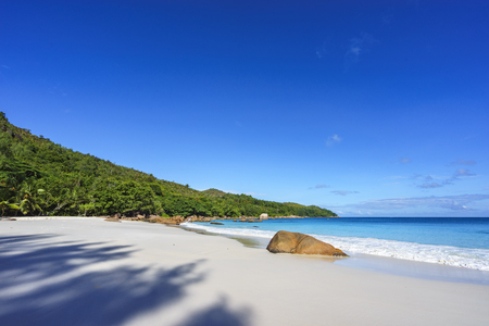 climas: Picturesque dream beach with white sand, golden granite rocks in the turquoise water and a blue sky at anse lazio on praslin island on the seychelles. Simply paradise...