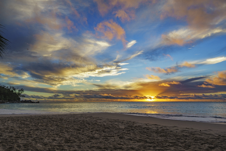 spectacular beautiful romantic glowing sunset on paradise beach anse georgette, praslin, seychelles Stock Photo