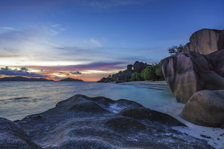 romantic sunset on paradise beach, famous anse source dargent, la digue, seychelles Stock Photo