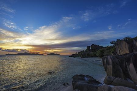 la digue: romantic sunset on paradise beach, famous anse source dargent, la digue, seychelles Stock Photo
