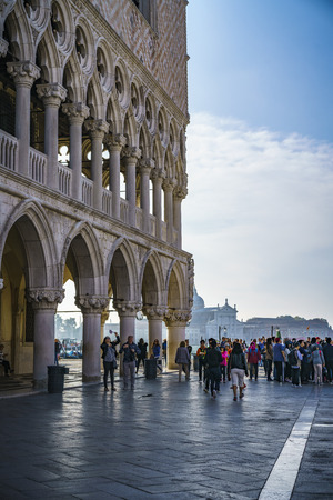 Many people on the st marks square in front of the doges palace in venice, italy Editorial