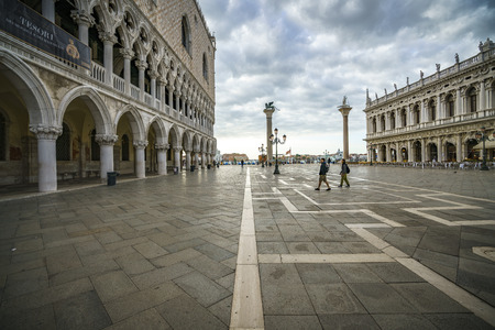 The Palazzo Ducale on the piazza San Marco in venice on a dark cloudy day Stock Photo - 90208098