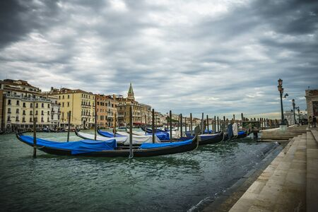 multiple blue gondolas in venice, italy Editorial