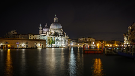 Basilica di santa maria della salute at night from the water in venice , italy Stock Photo