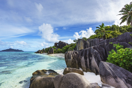 amazing picturesque paradise beach. granite rocks,white sand,palm trees,turquoise water at tropical beach anse source dargent, la dique, seychelles