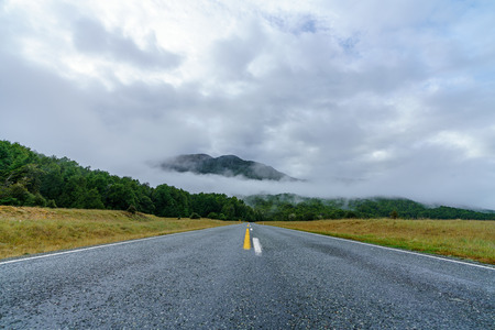 on the road in the mountains to milford sound, southland, new zealand Standard-Bild - 114580714