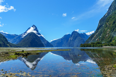 reflections of mountains in the water at famous milford sound,  fiordland, southland, new zealand 写真素材