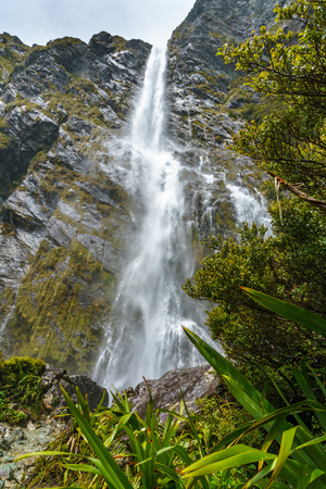 mighty waterfalls in the mountains, earland falls, southland, new zealand