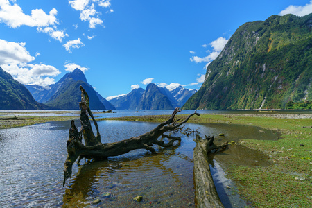 mountains in the clouds, famous milford sound, fiordland, new zealand