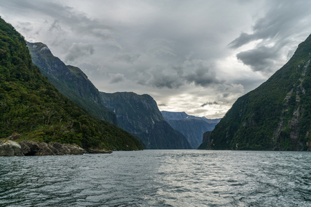 steep coast in the mountains at milford sound, fjordland national park, southland, new zealand
