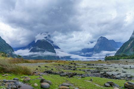 cloud shrouded peaks at famous natural wonder milford sound, fjordland national park, southland, new zealand Stock Photo