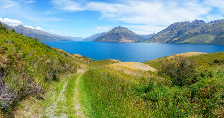 hiking jacks point track with view of lake wakatipu, queenstown, southern alps, otago, new zealand Imagens - 115688516