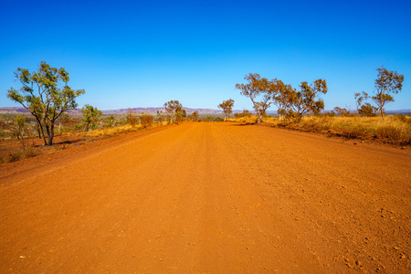 on the gravel road in the outback of karijini national park, western australia