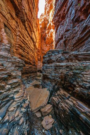 hiking to handrail pool in the weano gorge in karijini national park, western australia