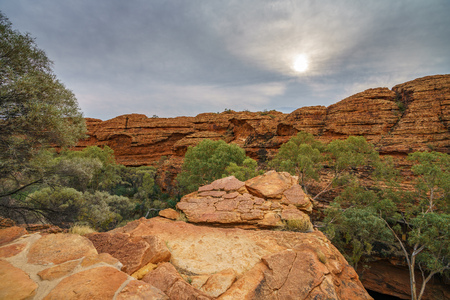 hiking on a cloudy day in the desert of kings canyon in watarrka national park, northern territory, australia Stock Photo