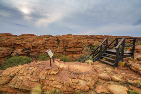 hiking the bridge in kings canyon on a cloudy day, watarrka national park, northern territory, australia