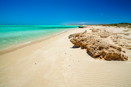 dream beach with turquoise water of sandy bay, cape range, western australia