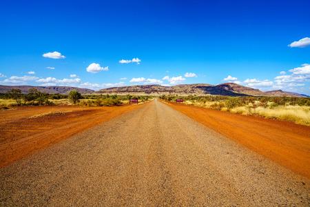 on the road in the desert of karijini national park, western australia