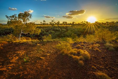 sun at sunset over joffre gorge in the desert of karijini national park, western australia