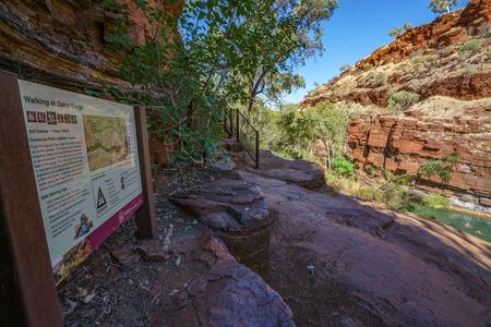 hiking over rocks in dales gorge, karijini national park, western australia