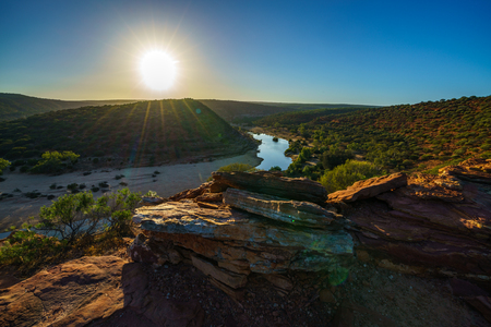Hiking the canyon. sun over natures window loop trail, kalbarri national park, western australia