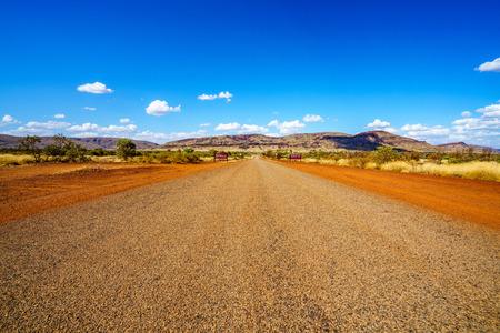 on the road in the desert of karijini national park, western australia Stock Photo