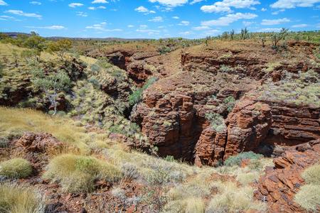 hiking at weano gorge rim in the desert of karijini national park, western australia