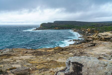 hiking on a cloudy day the royal national park coast track, new south wales near sydney, australia