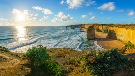 sun over the twelve apostles marine national park at sunset,great ocean road at port campbell, victoria, australia