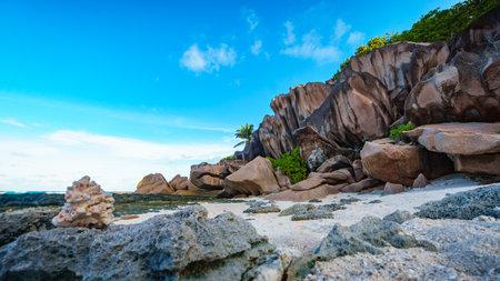 granite rocks at beautiful tropical beach grand anse on la digue on the seychelles