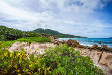 tropical rocky coastline at anse songe on la digue on the seychelles