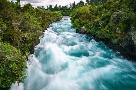 waterfall named huka falls in new zealand 免版税图像