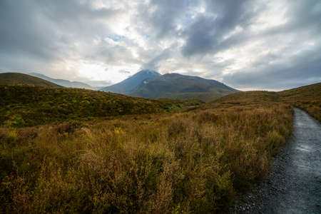 hiking the tongariro alpine crossing on cone volcano mount ngauruhoe in new zealand
