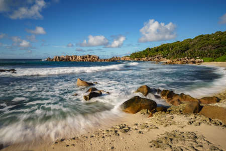 granite rocks at a beautiful tropical beach on la digue on the seychelles