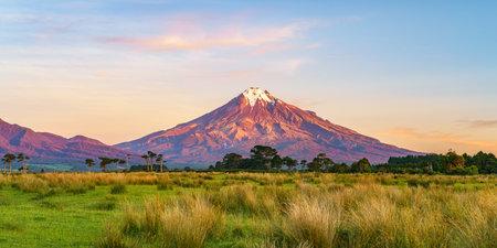 sunset at cone volcano mount taranaki in new zealand