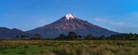 blue hour at cone volcano mount taranaki in new zealand