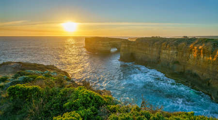 famous island arch at sunset, great ocean road in victoria, australia