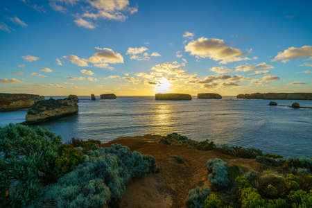 panorama of sunset at bay of islands, great ocean road, victory, australia
