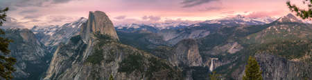 half dome and waterfalls from glacier point in yosemite national park at sunset, usa