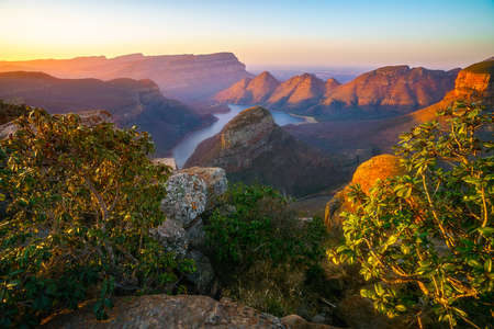 view of three rondavels and the blyde river canyon at sunset in south africa