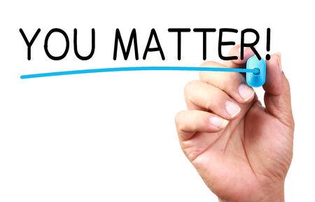 business matter: You Matter text with line written on transparent whiteboard.