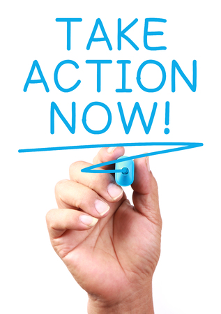 take action: Take Action Now written on transparent whiteboard.