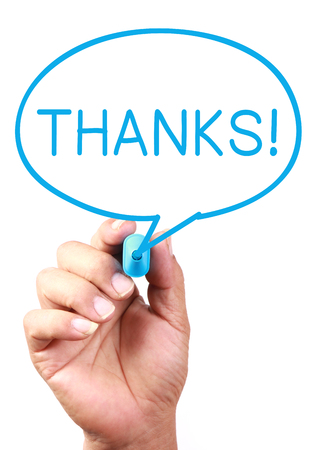 Say Thanks on transparent white board with blue marker. photo