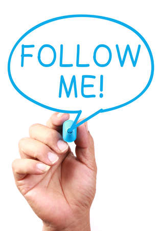 short phrase: Saying Follow Me on transparent white board with blue marker. Stock Photo