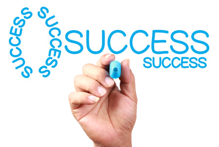 taget: Drawing Key Of Success on transparent white board with blue marker.